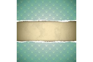 Torn green ornamental wallpaper