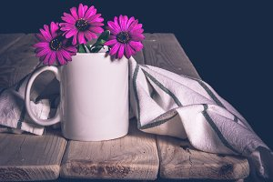 Cup white table of wood with flowers