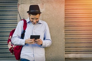 modern young man with the tablet in the street