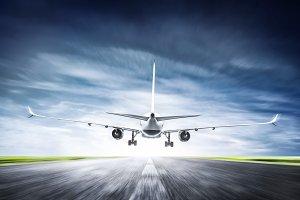 Passenger airplane taking off on runway
