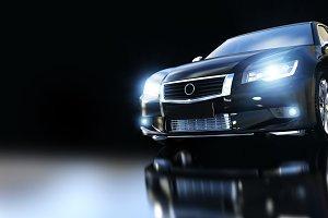 Modern black metallic sedan car in spotlight. Banner