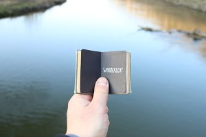 wanderlust idea, traveler holds a book with text
