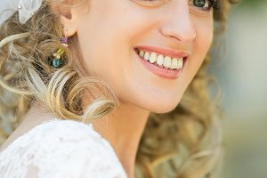 Bride with net smile and big eyes