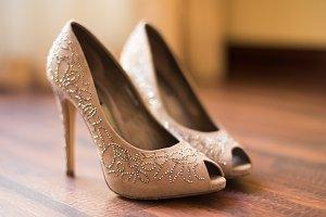 Open toe beige shoes on the floor
