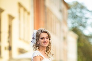 Bride in dress with violet bow