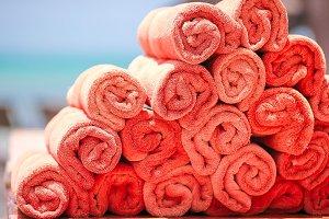 Orange beach towels background the sea