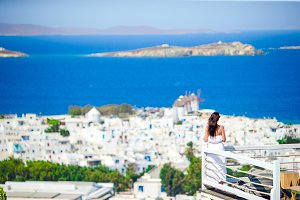 Happy tourist woman enjoy amazing view on Mykonos, Greece