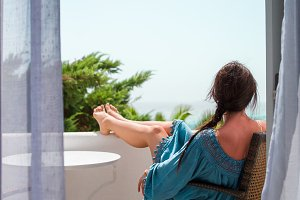 Back view of amazing woman enjoy sea view from her balcony