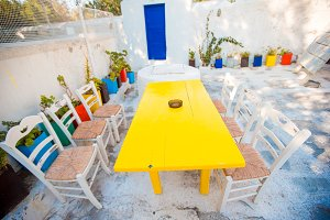 Summer empty openair cafe in popular area in Mykonos Little Venice