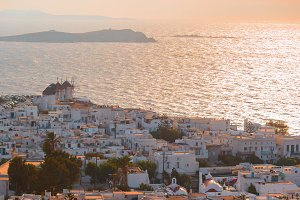 Top view of the old city and the sea on the island of Mykonos in evening lights