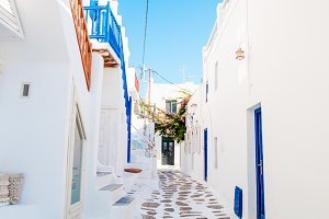 Empty narrow streets of greek old village. Beautiful architecture building exterior with cycladic style.