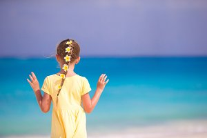 Beautiful girl at beach with flowers in her hair at caribbean vacation