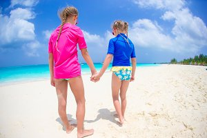 Kids having fun at tropical beach on caribbean vacation