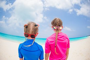 Portrait of back of kids having fun at tropical beach during summer vacation