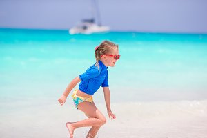 Adorable little girl having fun in shallow water