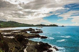 Rocky Coastline with isle & blue sea