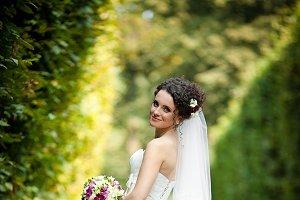 Elegant bride in long white gown