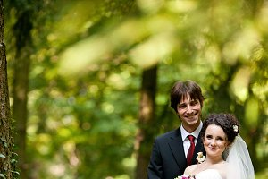 Fiance hugs tender bride from behind