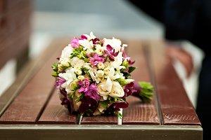 Beige and violet wedding bouquet