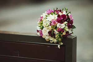 Wedding bouquet lies on the bench