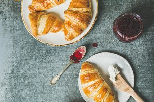 Freshly baked croissants with jam