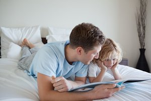 Father doing reading exercises with his son