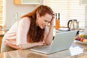 Woman looking confused at her laptop
