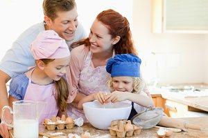 Happy family enjoys baking together