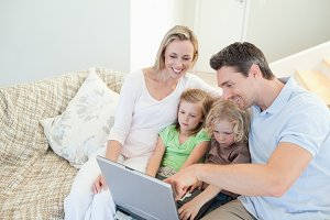 Family on the couch with laptop