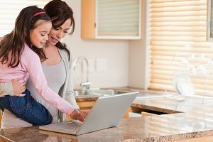 Girl and her mother using a laptop