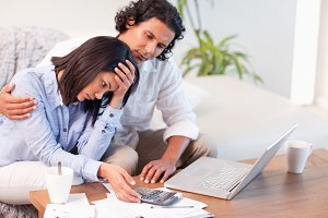 Side view of couple having a hard time paying their bills