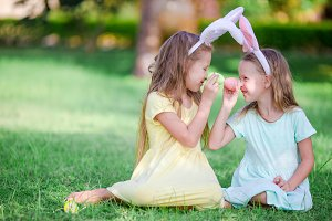 Kids in bunny ears have fun on Easter day outdoors