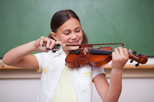 Schoolgirl playing the violin