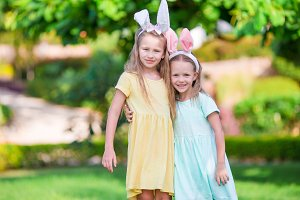 Little cute girls with bunny ears on Easter holiday