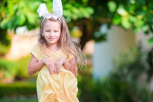 Little girl with bunny ears on Easter holiday