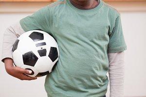 Portrait of boy holding a ball