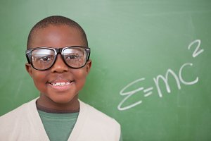 Schoolboy posing with the the massenergy equivalence formula