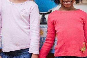 Portrait of schoolgirls holding hands