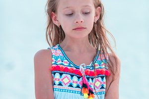 Adorable little girl at beach during summer vacation in the evening