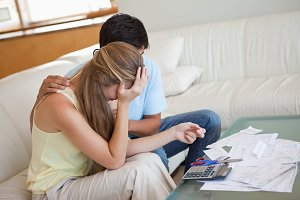 Sad couple in financial trouble