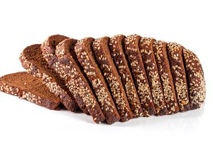 slices of black bread with sesame seeds isolated on white background