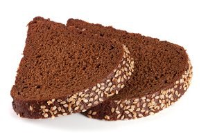 Two slices of black bread with sesame seeds isolated on white background