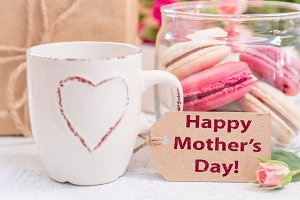 Mother's day card with coffee, present and macaroons