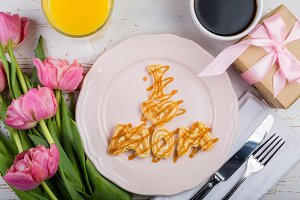 Mother's day breakfast concept - pancakes, coffee, flowers, present