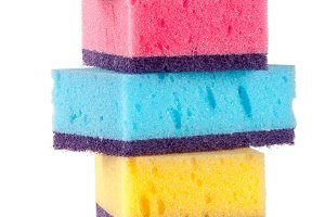 multicolored sponges for dishwashing isolated on a white background