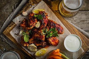 Chicken wings in on wood board