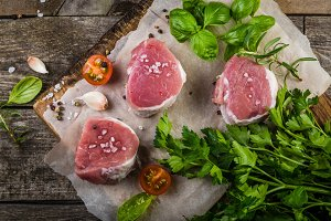 Raw filet mignon meat cuts with spice and herbs