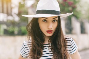 Stylish girl in white hat.