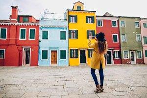 Tourist girl on Burano, Venice.