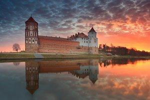 Castle on sunrise background